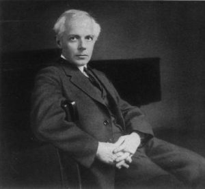 Béla Bartók, Portrait 1927. Photographer unknown. No known restrictions on publication. https://commons.wikimedia.org/wiki/File:Bart%C3%B3k_B%C3%A9la_1927.jpg