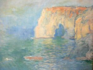 "<a href=""https://commons.wikimedia.org/wiki/File:Claude_Monet_%C3%89tretat,_la_Manneporte,_reflets_sur_l%27eau_15092012413.jpg"">Claude Monet</a>, <a href=""https://creativecommons.org/licenses/by-sa/3.0"">CC BY-SA 3.0</a>, via Wikimedia Commons"