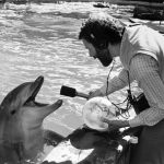 Jim Metzner with a dolphin