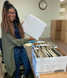 Zephaniah Galloway opens a box from the collection of Roy Wilkins, a civil rights activist with the National Association for the Advancement of Colored People (NAACP). Zephaniah was an AHHA intern in 2020.