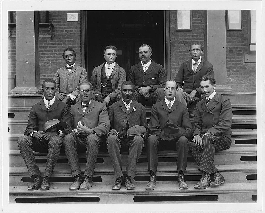 [George Washington Carver, full-length portrait, seated on steps, facing front, with staff]. Photo by Frances B. Johnston, ca. 1902. //hdl.loc.gov/loc.pnp/ppmsca.05633