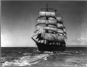Photograph shows the Star of Alaska sailing with full sails.