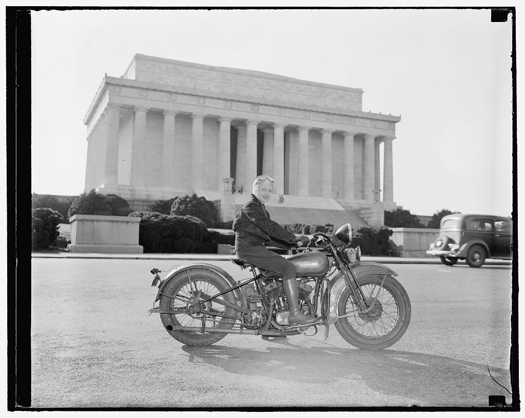 First of fair sex to obtain motorcycle license in Capital. Washington, D.C., Sept. 15. Although she weights only 88 pounds--one-third of the machine she rides, Mrs. Sally Halterman is the first woman to be granted a license to operate a motorcycle in the District of Columbia. She is 27 years old and 4 feet, 11 inches tall. Immediately after receiving her permit, Mrs. Halterman was initiated into the D.C. Motorcycle Club - the only girl ever to be accorded this honor. Photo by Harris & Ewing, 1937 September 15. //hdl.loc.gov/loc.pnp/hec.23371