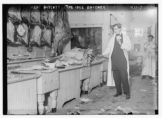 Butcher stands idle before his counter of meat during the meat boycott. Photo published by Bain News Service, 1910. //hdl.loc.gov/loc.pnp/ggbain.04485