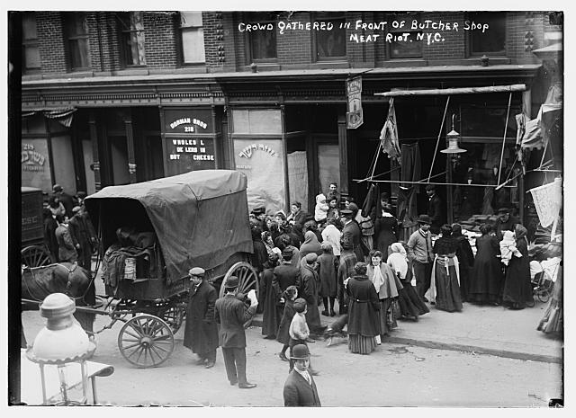 Crowd gathered in front of butcher shop during meat riot, New York. Photo by Bain News Service, 1910 April 9. //hdl.loc.gov/loc.pnp/ggbain.04610