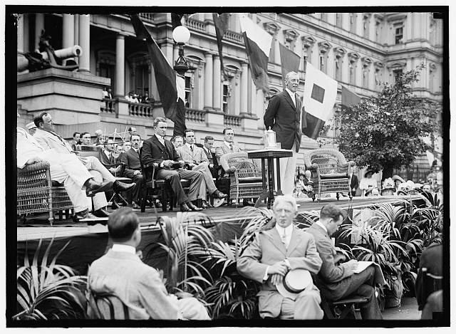 Flag Day exercises, State, War, and Navy Building. Wilson speaking; Bryan, Daniels, [Breckinridge Long], William Phillips, F.D. Roosevelt, etc. present. Photo by Harris & Ewing, 1914. //hdl.loc.gov/loc.pnp/hec.04395