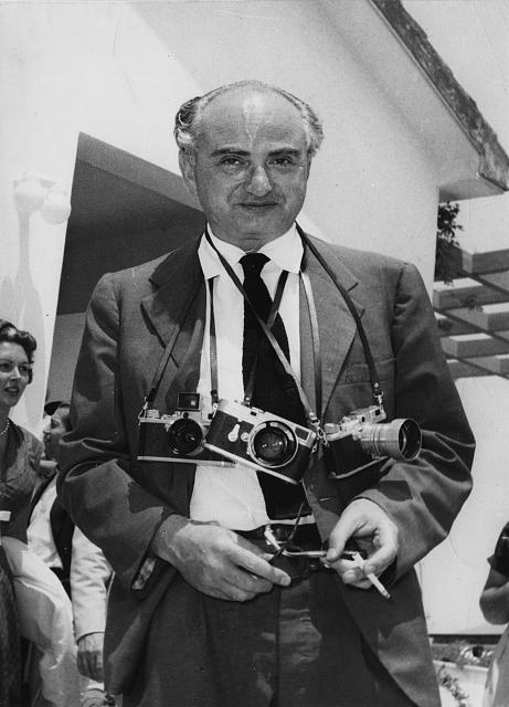 Photographer David Seymour (CHIM), with three Leica cameras around his neck. Photographer unknown, ca. 1950. //hdl.loc.gov/loc.pnp/ppbd.00599
