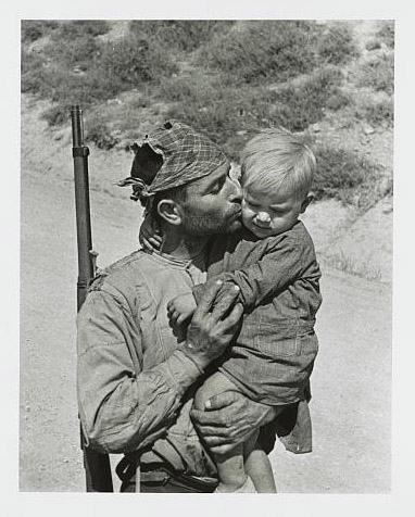Soldier kisses his son goodbye, Spain. Photo by CHIM, 1936. © Estate of David Seymour (CHIM)/Magnum, //hdl.loc.gov/loc.pnp/ppmsca.37988