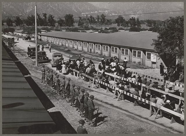 Japanese waiting for registration at the Santa Anita reception center. Photo by Russell Lee, 1942 April. //hdl.loc.gov/loc.pnp/ppmsca.38735