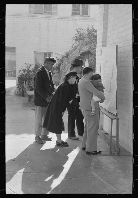 Los Angeles, California. Japanese-American evacuation from West Coast areas under U.S. Army war emergency order. Reading evacuation orders on bulletin board at Mary Knoll mission. Photo by Russell Lee, 1942 April. //hdl.loc.gov/loc.pnp/fsa.8a31179