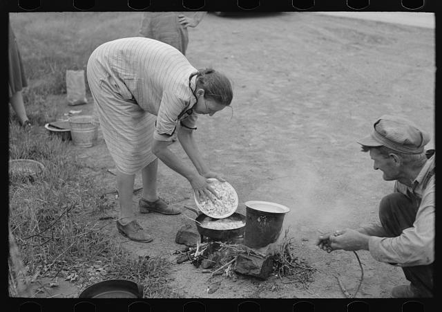 Making lunch along the roadside, near Henrietta [i.e., Henryetta,] Oklahoma. Photo by Russell Lee, 1939. (Photographic print found in class number.4528 - Cooking and Eating Outdoors). //hdl.loc.gov/loc.pnp/fsa.8a26714.