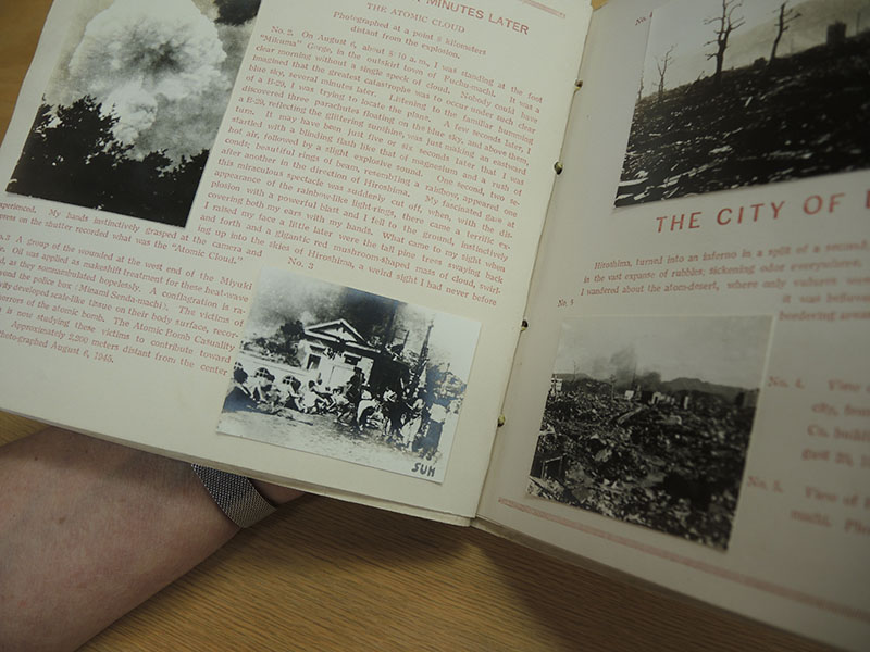 <em>Hiroshima: Photograph</em>, published by Hiroshima Peace Committee, featuring Yoshito Matsushige  photograph, lower left. Photo by Kristi Finefield.Hiroshima: Photograph by Hiroshima Peace Committee, featuring photograph by Yoshito Matsushige. Photo by Kristi Finefield, 2015.