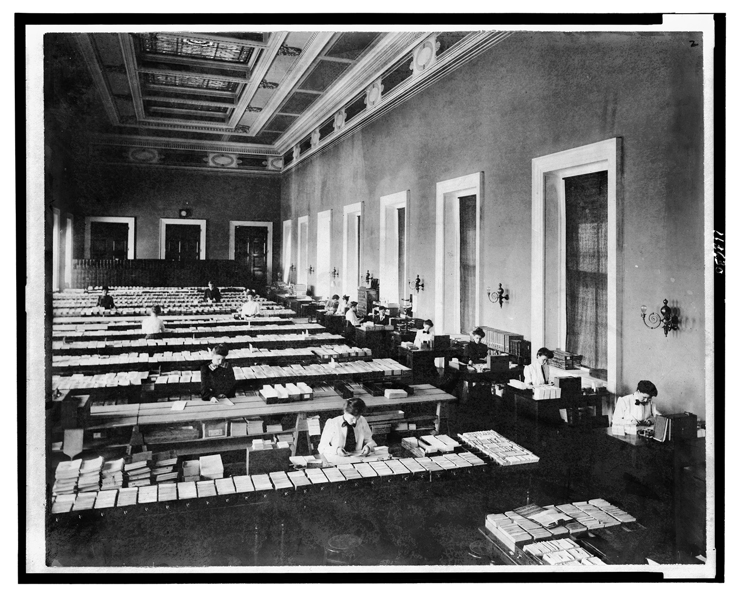 People working in card distribution room of the Card Division, Library of Congress, Washington, D.C. Photo , between 1900 and 1920. //hdl.loc.gov/loc.pnp/cph.3c20200