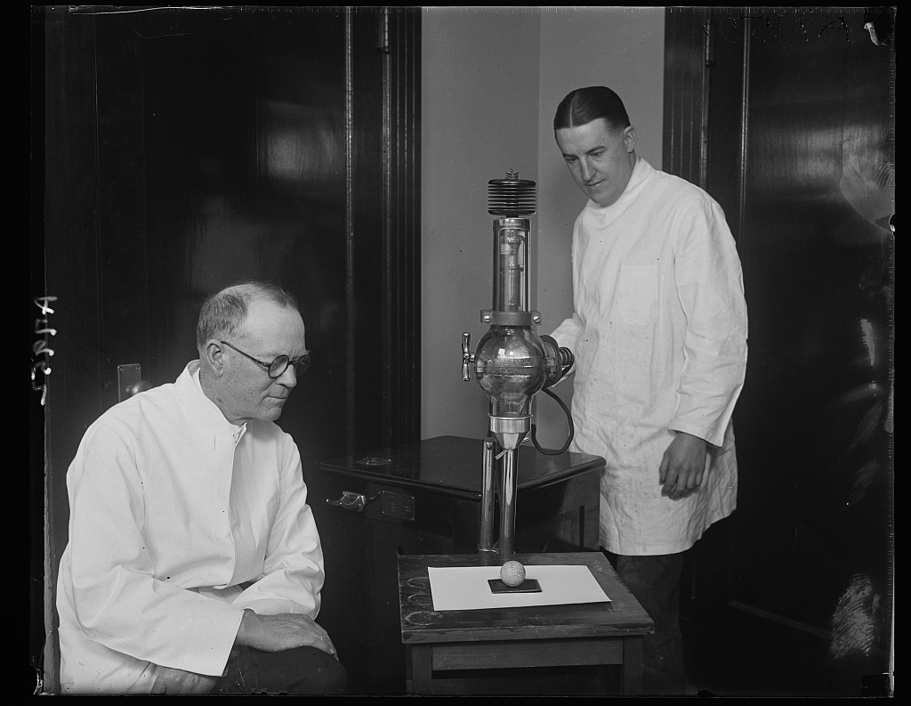 [Dr. B.L. Taylor (left) and Dr. Walter A. Rath (right), dentists, using a dental x-ray to examine the cores of golf balls to see if they are centered] Photo by Harris & Ewing, 1924. http://hdl.loc.gov/loc.pnp/hec.43996