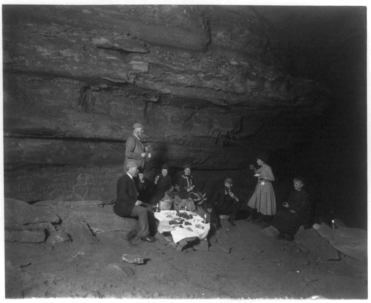 [Frances Benj. Johnston with group of men and women having picnic lunch inside Mammoth Cave, Ky.] Photo copyrighted 1891 by Frances Benjamin Johnston. //hdl.loc.gov/loc.pnp/cph.3b11192