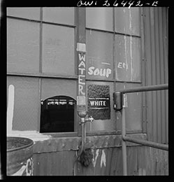 "Bethlehem-Fairfield shipyards, Baltimore, Maryland, May 1943. ""A drinking fountain."" [Sign: ""White.""]"