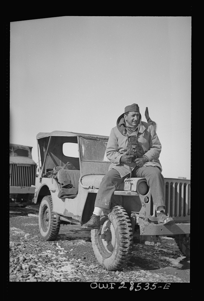 Somewhere in the Persian corridor. A United States Army truck convoy carrying supplies for Russia. OWI (Office of War Information) photographer Nick Parrino on the jeep which he rode in making a photographic record of the first run by an all-American convoy. Photo, 1943. //hdl.loc.gov/loc.pnp/fsa.8d29648