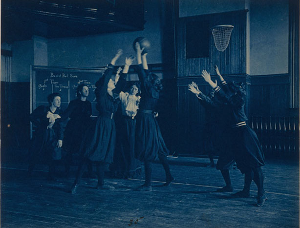 [Female students playing basketball in a gymnasium, Western High School, Washington, D.C.] Photograph by Frances Benjamin Johnston, circa 1899.