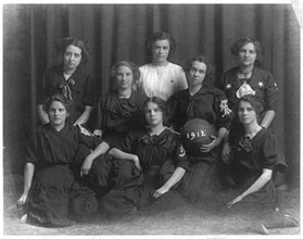 Photograph shows group portrait of an all girls basketball team.