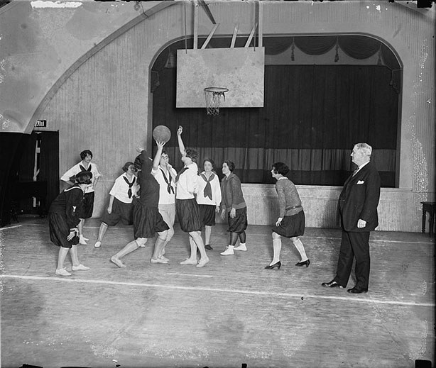 P.M. Gen. New with girls basketball team of Dept. Photo by National Photo Co., March 1, 1926.