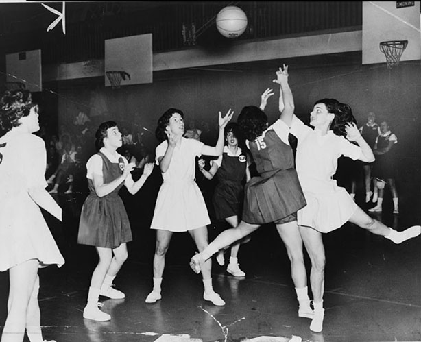 Rebound Sue Kelly in white and Ann Santorelli of St Johns 15 try for ball. NYWT&S staff photo by Wm. C. Greene, 1961.