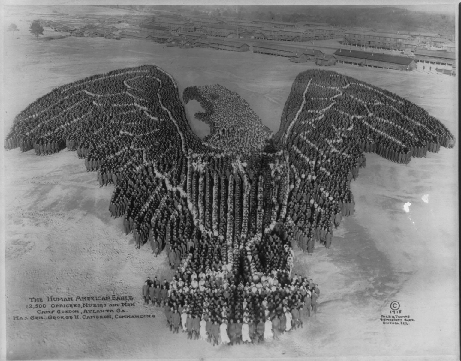 The Human American eagle; 12,500 officers, nurses and men; Camp Gordon, Atlanta, Ga.; Maj. Gen. George H. Cameron, commanding. Photo by Mole & Thomas, copyrighted 1918. hdl.loc.gov/loc.pnp/cph.3b11329