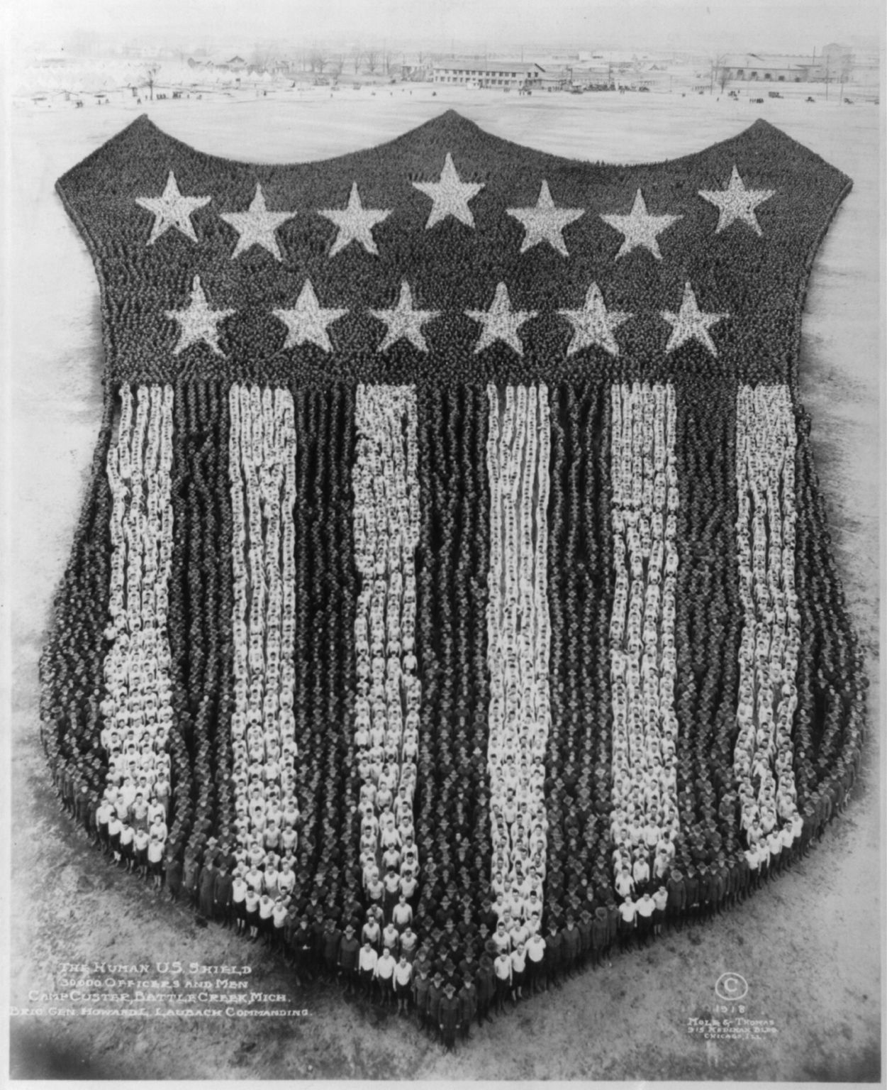 The Human U.S. Shield; 30,000 officers and men, Camp Custer, Battle Creek, Mich; Brig. Gen. Howard L. Lauback, commanding. Photo by Mole & Thomas, copyrighted 1918. hdl.loc.gov/loc.pnp/cph.3b24427