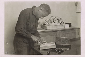 Wood Carving. Gelatin silver photograph by Lewis W. Hine for the American Red Cross, circa June 1920.