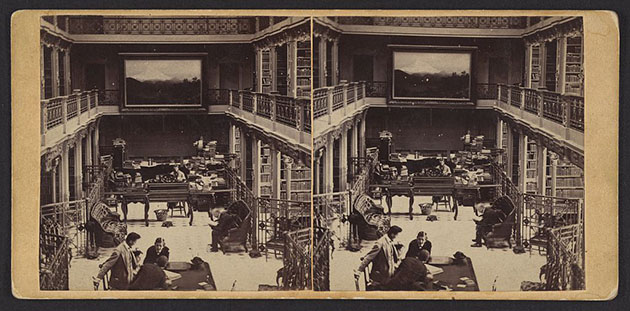 Stereograph showing an interior view of the Library of Congress with reading room and stacks in the U.S. Capitol building.