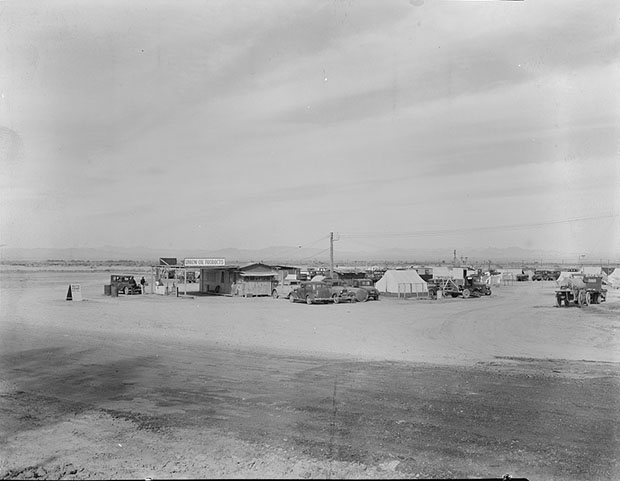 Auto camp north of Calipatria, California. Approximately eighty families from the Dust Bowl are camped here. They pay fifty cents a week. The only available work now is agricultural labor. Photograph by Dorothea Lange, March 1937. //hdl.loc.gov/loc.pnp/fsa.8b31758