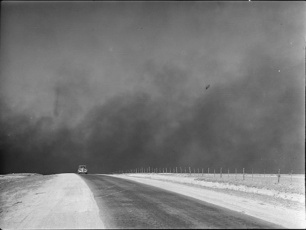 Heavy black clouds of dust rising over the Texas Panhandle, Texas. Photograph by Arthur Rothstein, March 1936. //hdl.loc.gov/loc.pnp/fsa.8b27276