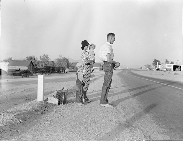 Example of self-resettlement in California. Oklahoma farm family on highway between Blythe and Indio. Forced by the drought of 1936 to abandon their farm, they set out with their children to drive to California. Picking cotton in Arizona for a day or two at a time gave them enough for food and gas to continue. On this day, they were within a day's travel of their destination, Bakersfield, California. Their car had broken down en route and was abandoned. Photograph by Dorothea Lange, August 1936. //hdl.loc.gov/loc.pnp/fsa.8b38486