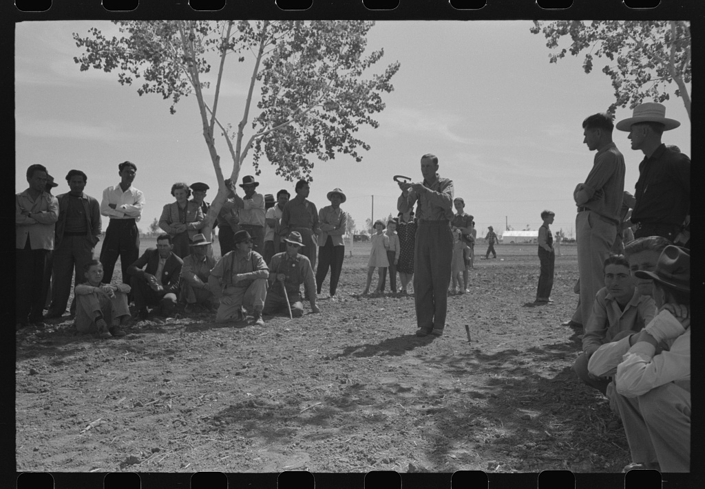Croquet [horseshoes] game at the annual field day of the FSA (Farm Security Administration) farmworkers community, Yuma, Arizona. Photo by Russell Lee, March 1942. hdl.loc.gov/loc.pnp/fsa.8a31079