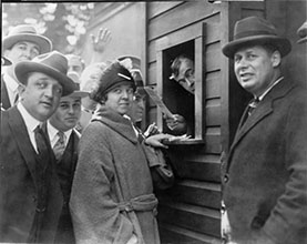 Miss Elsie Tydings and other fans at ticket booth.
