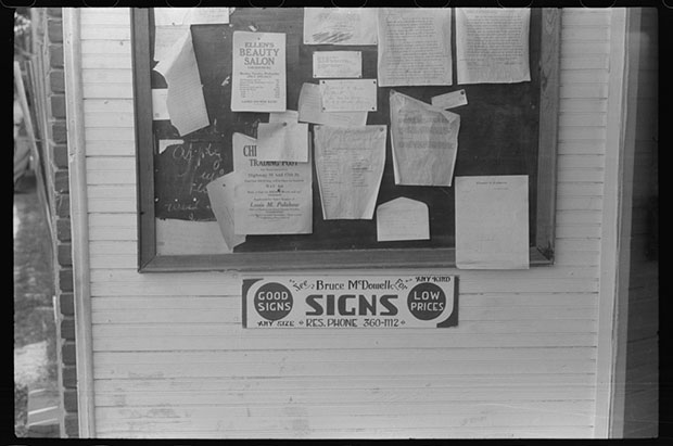 Signs on the post office bulletin board in Childersburg, Alabama