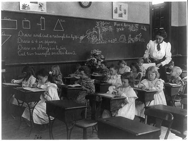 Grade school, Washington, D.C. - children drawing and cutting rectangles, triangles, etc. Photo by Frances Benjamin Johnston, 1899? //hdl.loc.gov/loc.pnp/cph.3b26481