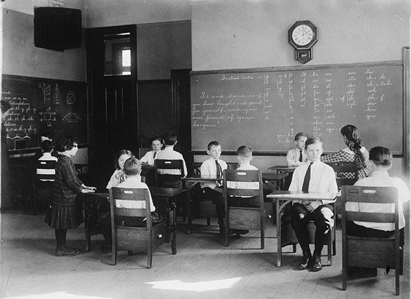 Classroom interior with students and blackboard. Photo by Detroit Publishing Company, between 1910 and 1930. //hdl.loc.gov/loc.pnp/det.4a27667