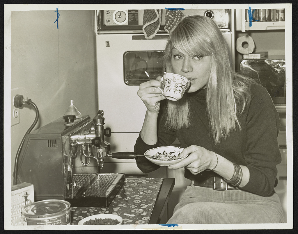 Mary Travers, half-length portrait, seated in kitchen, drinking a cup of coffee. Photo by John Bottega, World Telegram & Sun, November 17, 1965. //hdl.loc.gov/loc.pnp/ds.06607