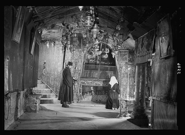 Bethlehem, Church of Nativity. The Grotto front view with Greek monk trimming lamp. Photo by American Colony Photo Dept., between 1939 and 1939. //hdl.loc.gov/loc.pnp/matpc.22413