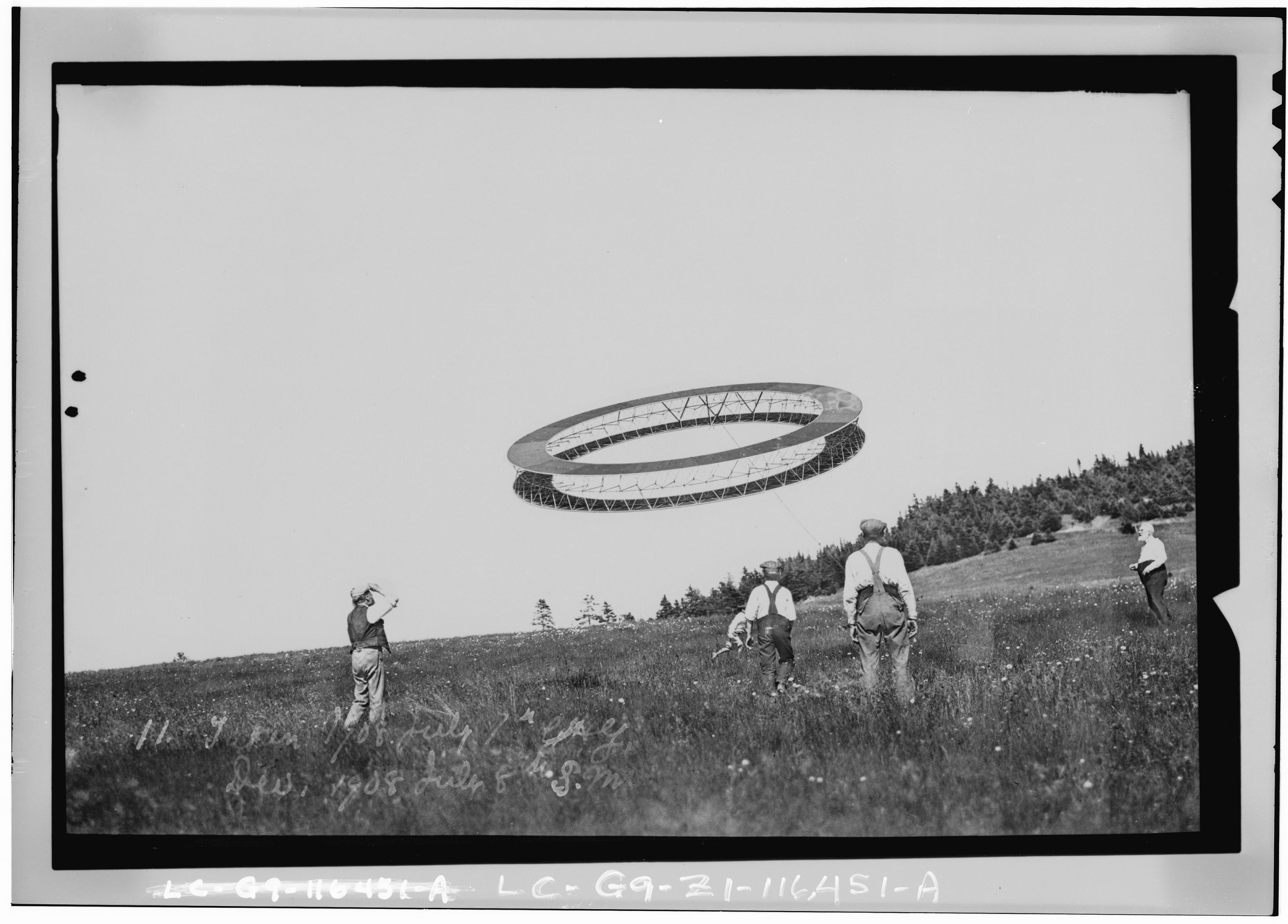 Alexander Graham Bell (right) and his assistants observing the progress of one of his tetrahedral kites. Photo, 1908 July 7. hdl.loc.gov/loc.pnp/ppmsc.00887