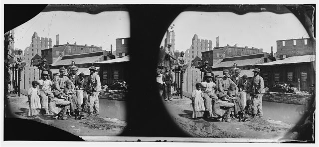 "Glass stereograph negative used for illustration above. Title from Civil War caption log: Richmond, Virginia. Group of Negroes (""Freedmen"") by canal. Photograph, 1865, April. //hdl.loc.gov/loc.pnp/cwpb.00468"