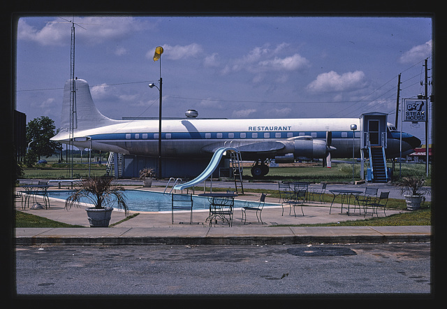 DC-7 Steak House with airplane next to swimming pool. Byron, Georgia. Photograph by John Margolies. 1982. //hdl.loc.gov/loc.pnp/mrg.07360