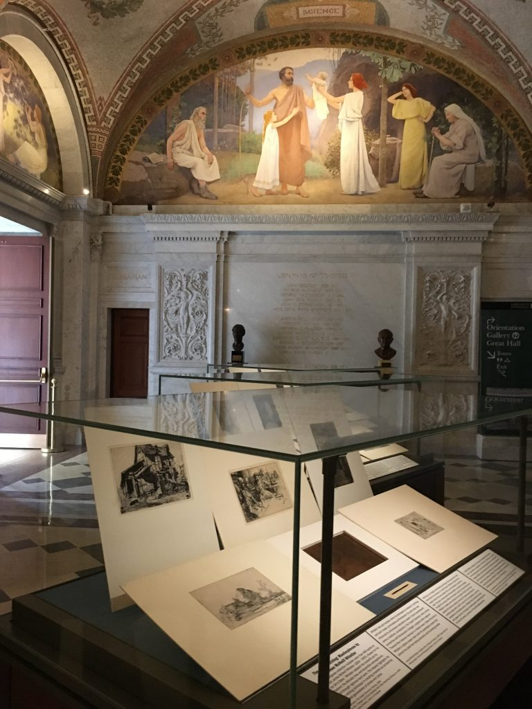 "One of three ""Art of Etching"" display cases, with Pennell's etching needle and an original copper plate in center of case. Photo by Katherine Blood, 2017."
