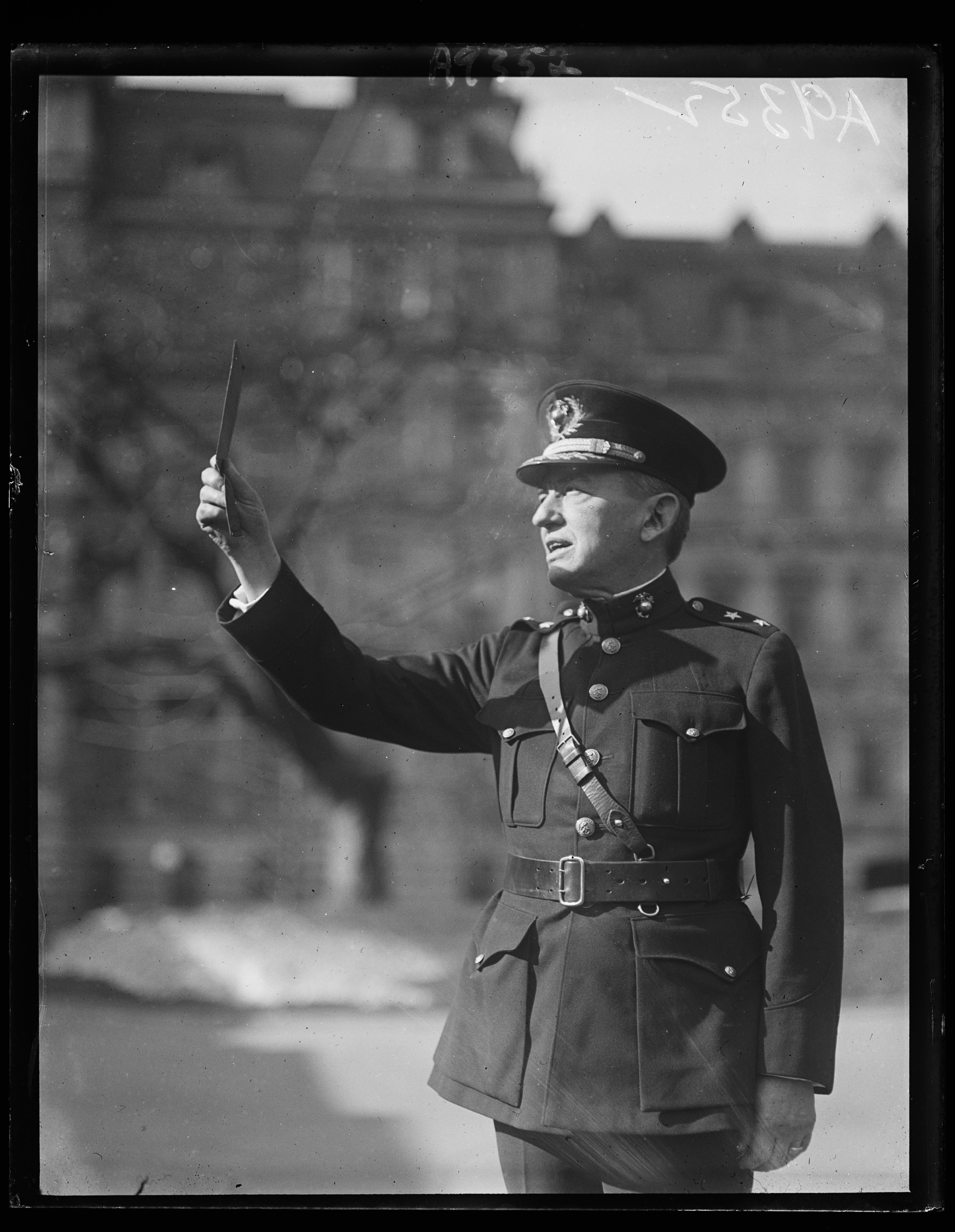 General John A. LeJeune, Commandant of the U.S. Marine Corps, viewing the eclipse in front of the Navy Department at Washington. Photo by Harris & Ewing, 1925 January. //hdl.loc.gov/loc.pnp/hec.44780