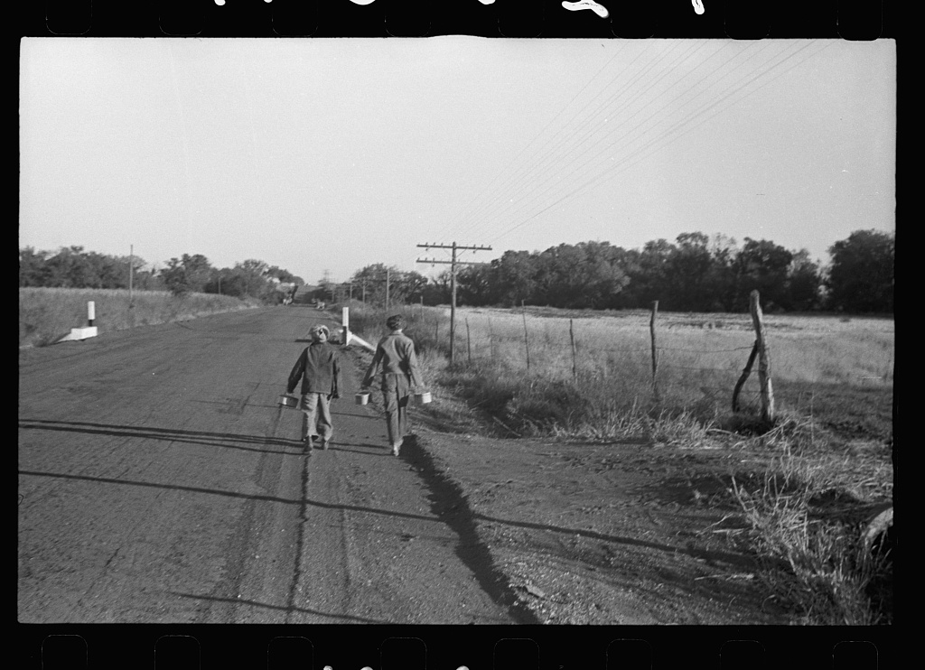 Farm children walking to one-room schoolhouse with lunch pails, Nebraska. Photo by John Vachon, 1938 Oct. //hdl.loc.gov/loc.pnp/fsa.8a03638