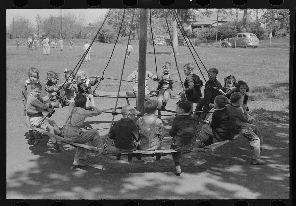 Schoolchildren on circular swing, San Augustine, Texas. Photo by Russell Lee, 1938 Sept.-Oct. //hdl.loc.gov/loc.pnp/fsa.8a25893