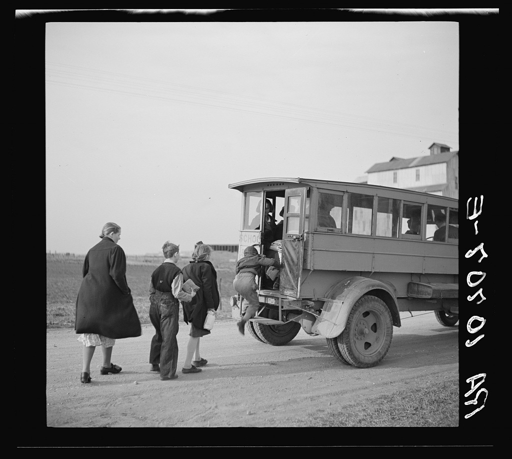 Tip Estes' children boarding a school bus near Fowler, Indiana. Photo by Russell Lee, 1937 Apr. //hdl.loc.gov/loc.pnp/fsa.8b30308