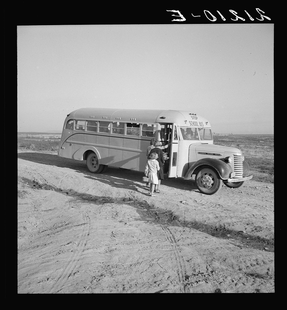 Dead Ox Flat. Children get into school bus on a fall morning. Malheur County, Oregon. Photo by Dorothea Lange, 1939 Oct. //hdl.loc.gov/loc.pnp/fsa.8b35057