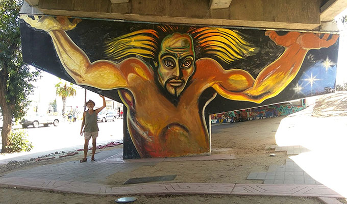 Artist Mario Torero with his Colossus mural, Chicano Park, San Diego, California. Photo by Marianne Peterson, 2017. By permission of the artist.