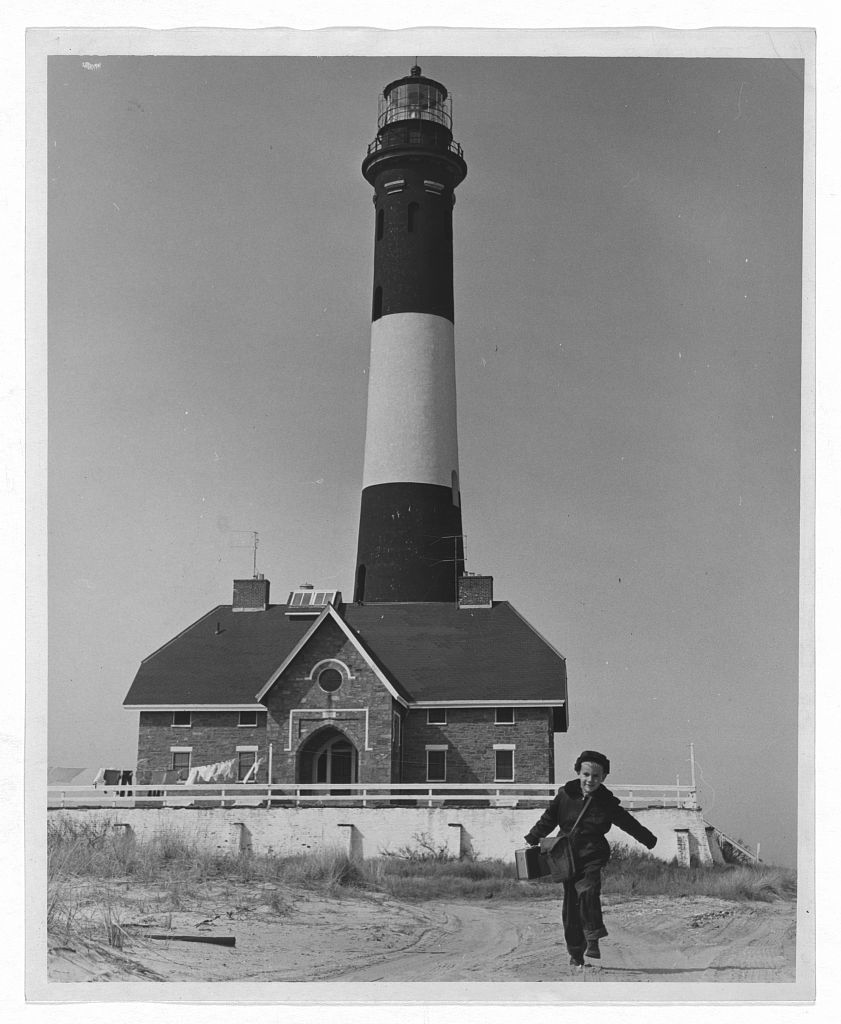 Richard Mahler (5) is the Fire Island School's youngest pupil and lives the farthest away. His father is the lighthouse keeper and, since the lighthouse is about four miles away, school is a long ride by jeep. Photo by Roger Higgins, 1952. //hdl.loc.gov/loc.pnp/ppmsca.09037